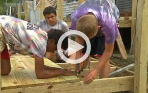 Teens helping build a wheelchair ramp