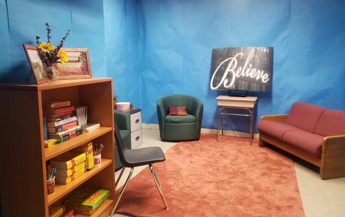 Blue room with a sign that says Believe